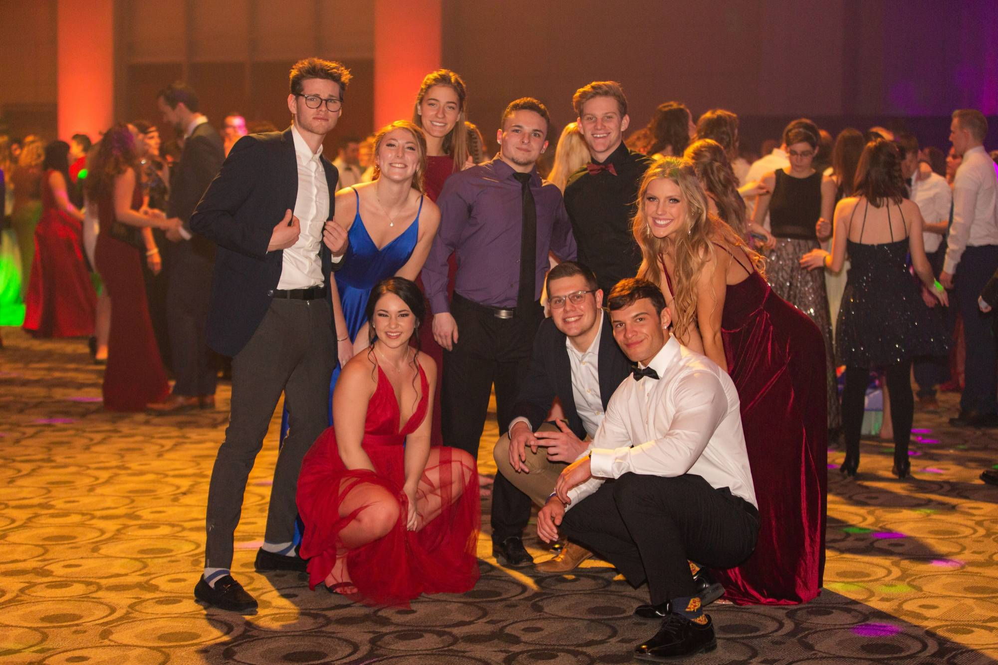 Students at president's ball posing for a group picture